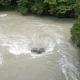 Fluss von Brücke nach Taifun